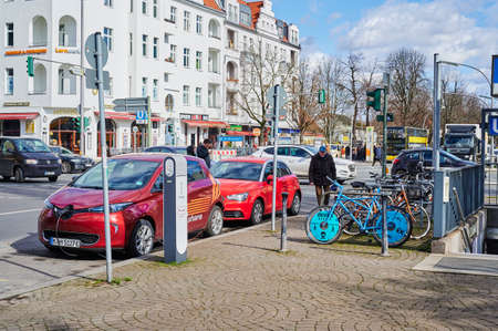 Berlin, Germany - March 11, 2020: View to an electric car that is being charged at a public charging station.
