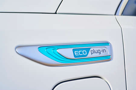 Berlin, Germany - November 8, 2019: Emblem ECO plug-in on an ecofriendly car. 新聞圖片