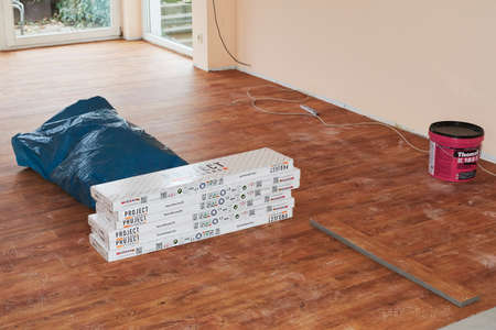 Berlin, Germany - November 21, 2018: Wood grain vinyl flooring when laid on the floor.