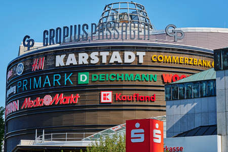 Berlin, Germany - September 17, 2020: Advertising space with different company names and logos on the facade of a shopping center in the south of Berlin.