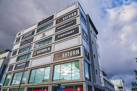Berlin, Germany - October 5, 2019: Advertising space with different company names and logos on the facade of a shopping center in Berlin.