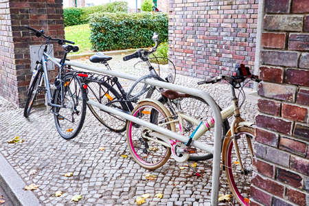 Berlin, Germany - November 15, 2020: Parked bikes at an autumn day in Berlin, Germany. 新聞圖片