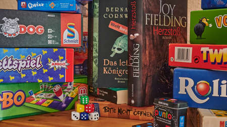Berlin, Germany - September 6, 2020: Books and many different packs of board games. 新聞圖片