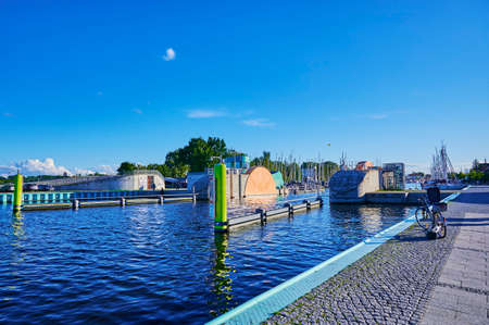 Weir system against flooding at the port of Greifswald in Germany on a sunny day under a blue sky.