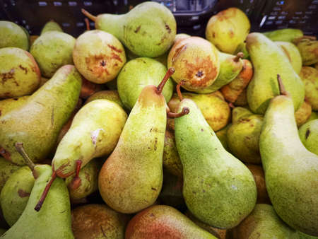 View to a shelf with pears in a supermarket. Stock fotó