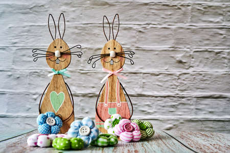 Two wooden Easter bunnies with decoration.