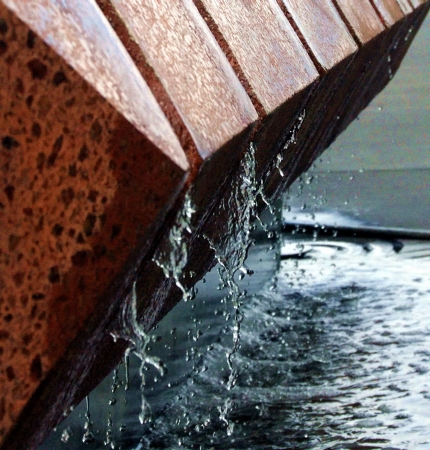 spaying: red stone water feature,fountain spaying water drops