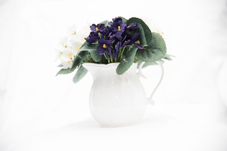 Rustic jug shaped vase with flowers