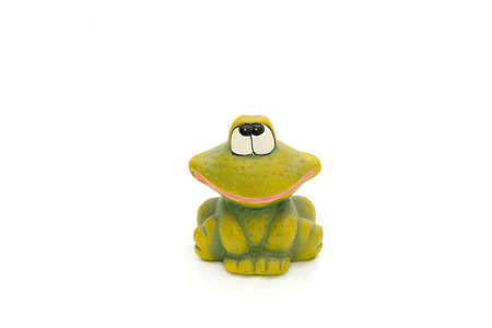 Small frog rolling its eyes, isolated white background. Stok Fotoğraf