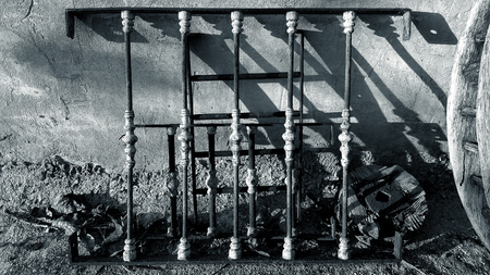 Spanish garden wall with rusty rehas metal bars