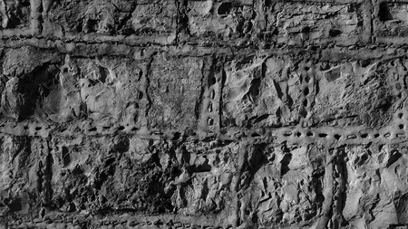 Stone wall with strap pointing and flint inserts black and white, monochrome Imagens