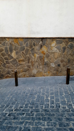 Metal bollards on a stone street