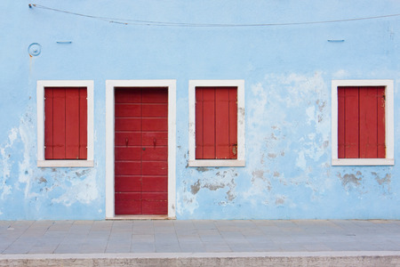 frontage: View on a facade of Burano, Italy