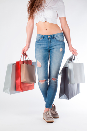 ass standing: One white woman standing with shopping bags