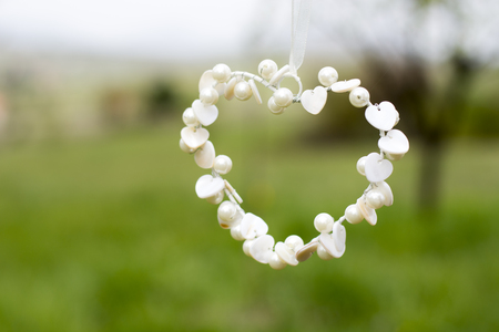 pom: Handmade white heart shape sign with pearls