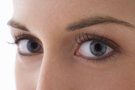 Close up view of the eyes of a young woman as she looks at the camera. Horizontal shot. photo