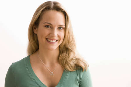 Portrait of an attractive young woman smiling towards the camera.  Horizontal shot. Stock Photo - 7467101