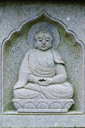 chinese buddha: Chinese Buddha engraved in stone  Stock Photo