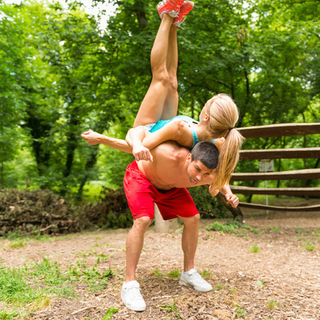 Fitness couple exercising in nature Stock Photo