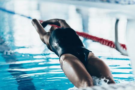backstroke: Backstroke Swimming Start - lady swimmer taking off