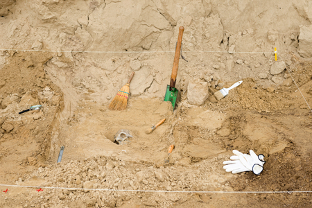 archaeology: Archaeology tools at excavation site, work in progress