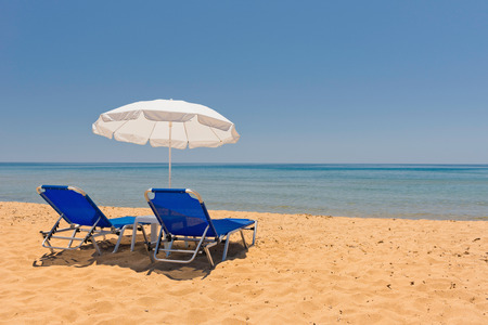 sun umbrella: Sun loungers and sun umbrella on the beach
