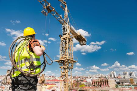 Construction worker under the tower crane