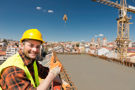 thumbsup: Going up - positive construction worker showing thumbs-up on high-rise city construction site
