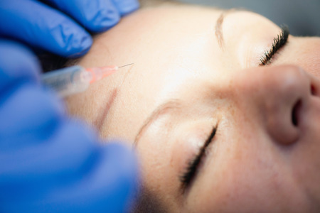 Botox injection to forehead wrinkles