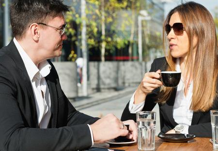 informal clothing: Business people having informal conversation over coffee