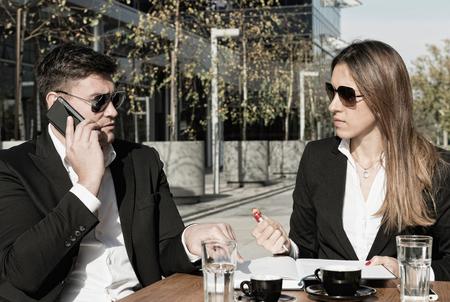 sidewalk talk: Business talk in a sidewalk cafe in financial district