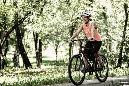high contrast: Young woman riding bicycle. High contrast, desaturated image Stock Photo