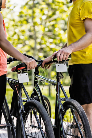 Renting: Young couple renting bicycles Stock Photo
