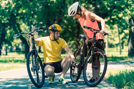 toned image: Young couple with bicycles. Toned image