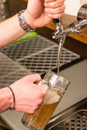 pouring beer: Beer rap - Bartender pouring beer