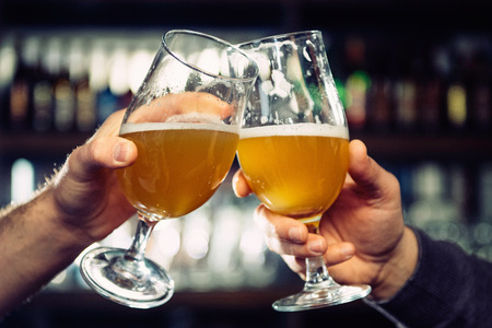 drinks after work: Toasting with beer in a bar