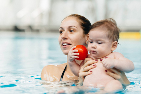 6 12 months: Mother and baby in swimming pool