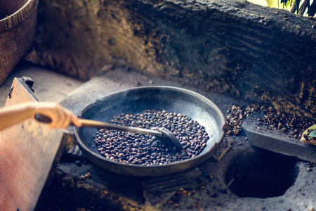 kopi: Traditional method of coffee roasting on a civet coffee farm in Indonesia. Coffee is produced from beans that have been eaten and defecated by civets. Also known as Kopi Luwak, this type of coffee is famous for its non-acidic, smooth taste and is one of t