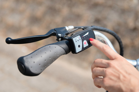 Turning on electric bike or E-bike Stock Photo - 53688796