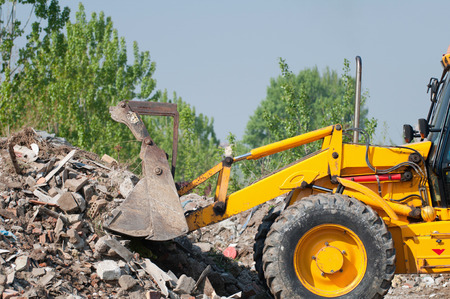 front loader: Front end loader working with piles of rubble Stock Photo