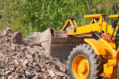 loader: Loader clearing piles of rubble Stock Photo