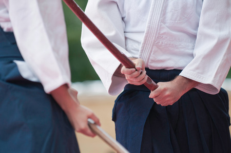 combative sport: Aikido fighters with bokkens, traditional Japanese wooden swords Stock Photo