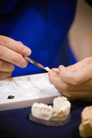 artificial model: Dental prosthetic technician at work, selective focus