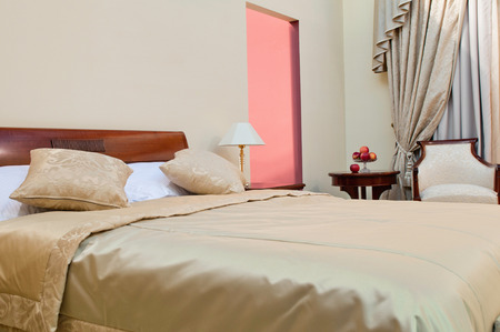 pillow case: Elegant hotel room with bed and armchair