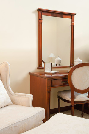 dressing table: Dressing table and other furniture in a luxury hotel room