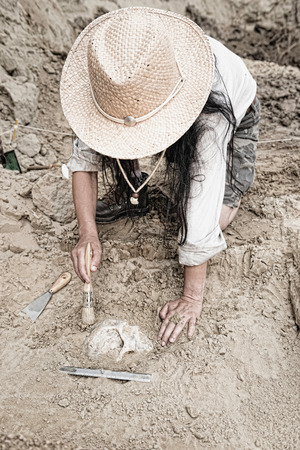 archaeologist: Archaeologist carefully revealing ancient human remains Stock Photo