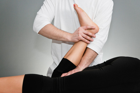 adjustment: Chiropractic adjustment - Chiropractor working with patient Stock Photo