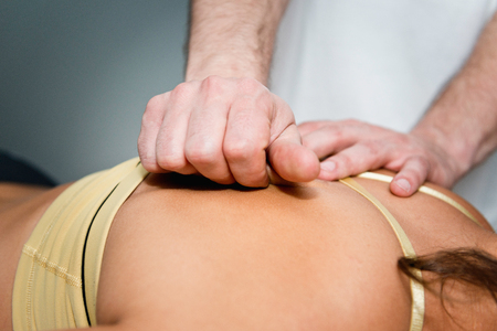 skeletal muscle: Myofascial Release - practitioner working on patients back