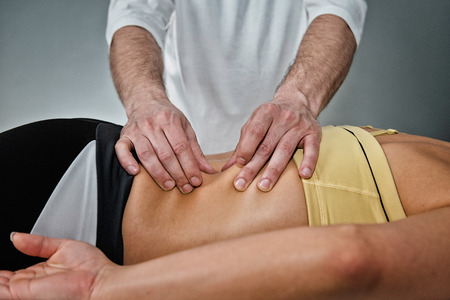 myofascial: Osteopath working with patient