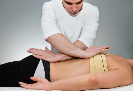 osteopath: Osteopath working on patients back